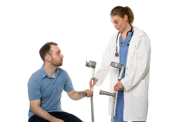Male Patient Gets Crutches from Woman Doctor
