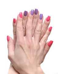 Women's hands with a colored nail polish