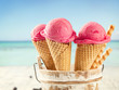 Ice cream scoops in cones with blur beach - 65824396