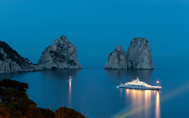 Faraglioni by night, famous giant rocks, Capri island