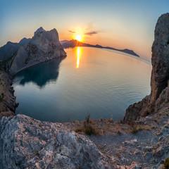 Mountain and sea landscape through fisheye lens