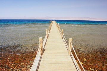 Wooden pier leading to the Red Sea, Egypt