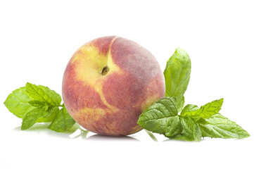 Fresh Peach and leaves of mint on the white