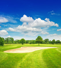golf course and beautiful blue sky. green field