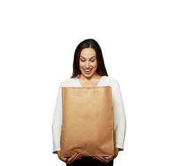 woman looking into the paper bag