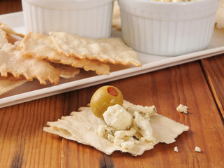 Feta cheese and olives on flatbread crackers