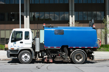 Street cleaning machine parked on the street