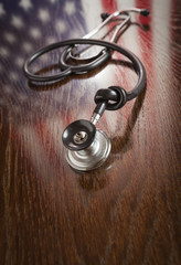 Knotted Stethoscope with American Flag Reflection on Table
