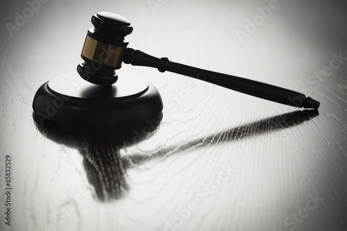 Dramatic Gavel Silhouette on Reflective Wood - 65832529