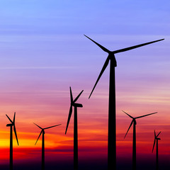 wind turbine silhouette on colorful sunset