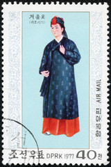 stamp shows  woman in traditional North Korean costume