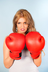 beautiful woman with attitude wearing red boxing gloves
