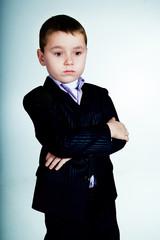 Portrait of thoughtful little boy looking down