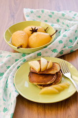 pear stewed in citrus juice and pancakes