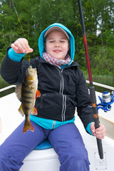 Happy boy with perch fish trophy