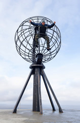 Man in the North Cape globe