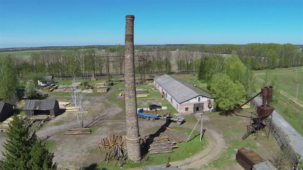 Old pipe on sawmill .Aerial