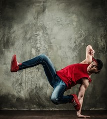 Man dancer showing break-dancing moves