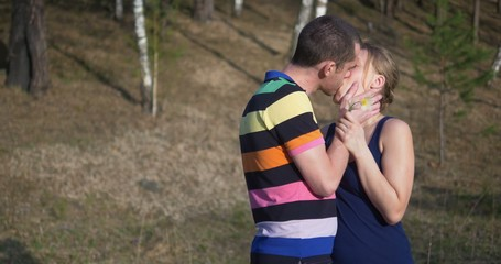 young couple outdoors. Man give spring flower. Ultra HD 4K video