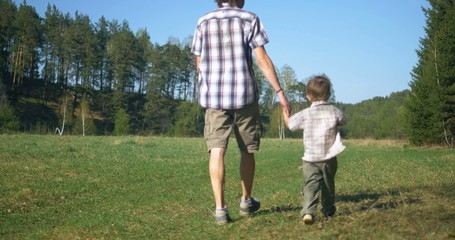 father walking with son outdoors