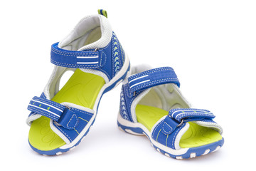 pair of blue sandals for kid on white background, front view