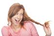 canvas print picture - Junge Frau zieht lachend an ihrem Zopf