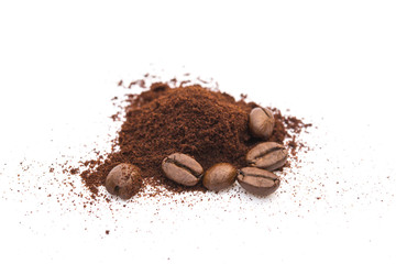 coffee beans and powder on a white background