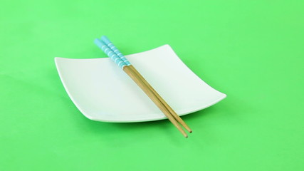 plate chopsticks turning on green screen