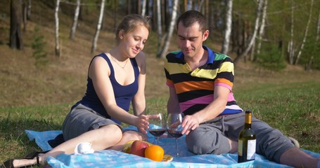 Young couple at picnic with wine. Ultra HD 4K video