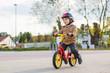 Little toddler boy having fun and riding his bike - 65845974