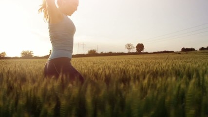 Young Beautiful Fit Female Model Running Through Wheat