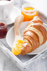 fresh croissant with jam for breakfast