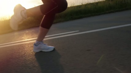 Female Runner Legs Feet Running at Sunset Healthy Active