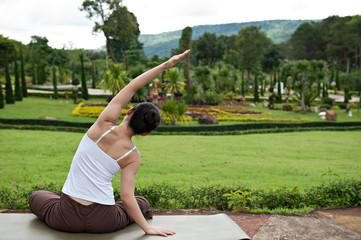 Yoga posing in garden