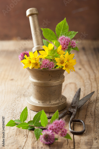 mortar with flowers and herbs