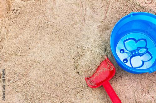Children's toys in the sandbox. - 65846998