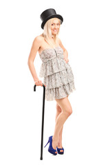 Fashionable female with retro hat and a cane