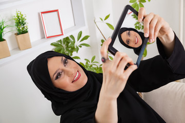 Arabic Woman Taking Selfie