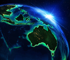 land area in Australia, and Indonesia the night