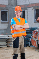 Builder standing at building area