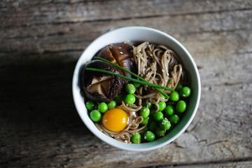 Soba noodles with green peas, shitake mushroom and quail egg