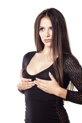 startled young woman holding her breasts