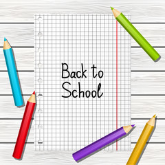 Back to school message on wooden background