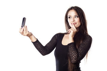 pretty young woman make a self-portrait with her phone