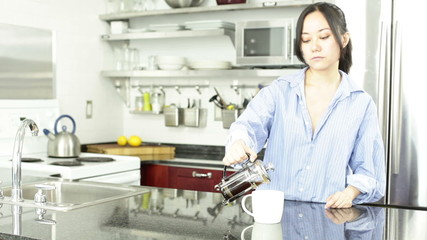 Asian girl in her kitchen