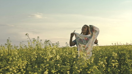 Young Beautiful Vintage Woman Running Through Rapeseed Field