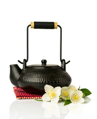 Asian teapot with fresh jasmine flowers