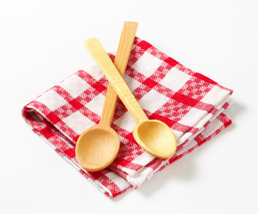 Checked tea towel and wooden spoons