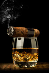 whiskey and smoking a cigar