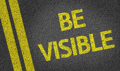 Be Visible written on the road